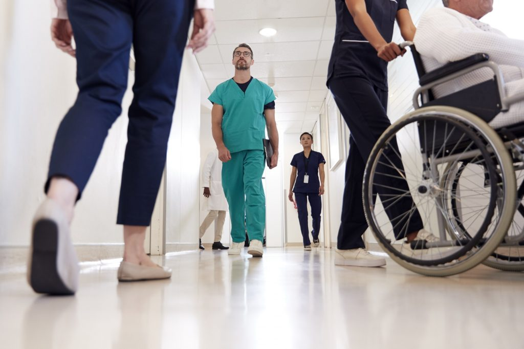 Busy Hospital Corridor With Medical Staff And Patients